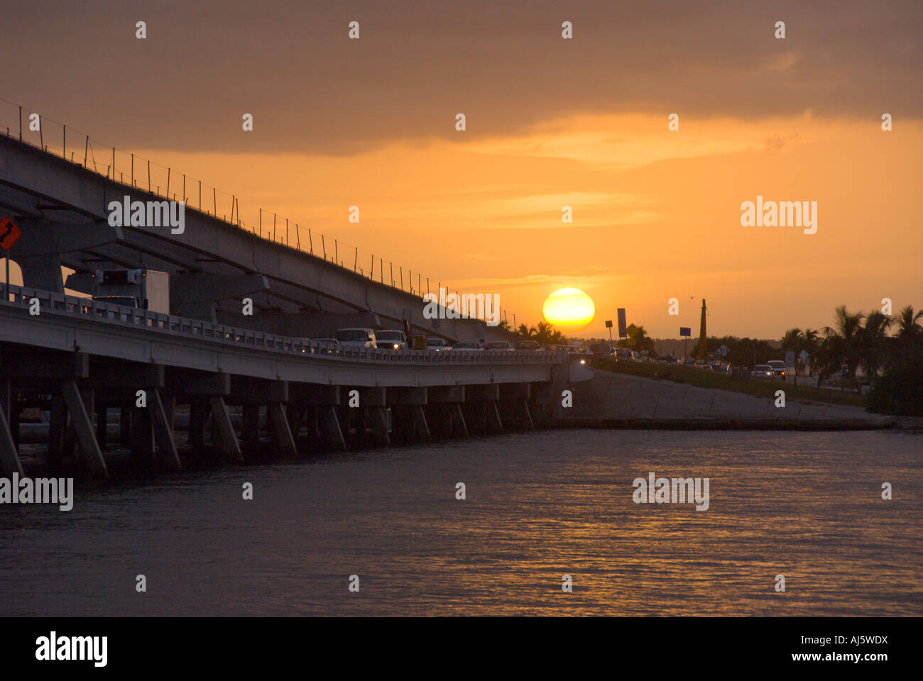 Causeway from Fort Myers to Sanibel silhouette at sunset Florida fl fla tourist destinatrion - Stock Image