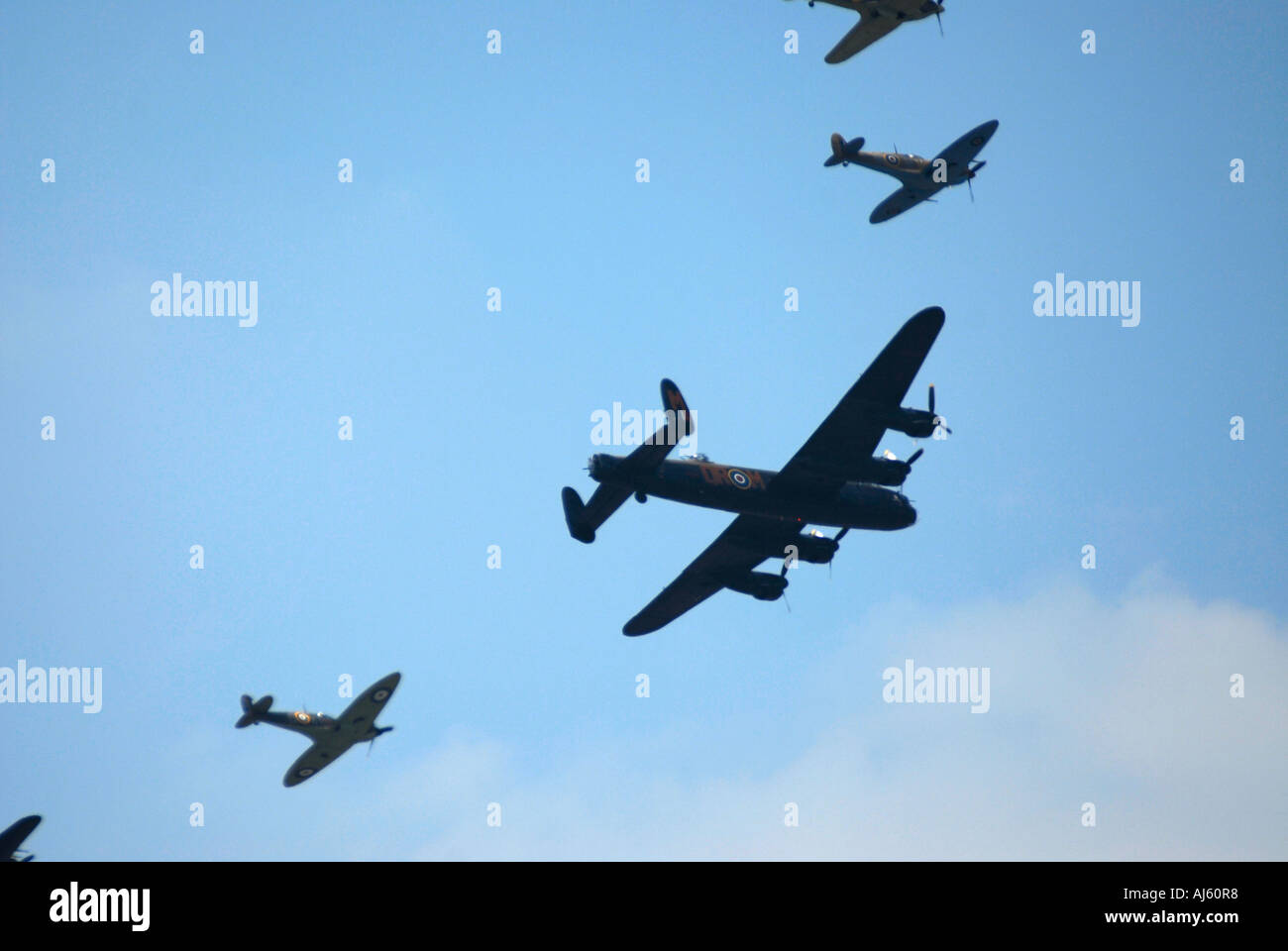 A World War Two Lancaster, Spitfires and Hurricanes on a flypast over The Mall on the 80th birthday of HM Queen Elizabeth London - Stock Image