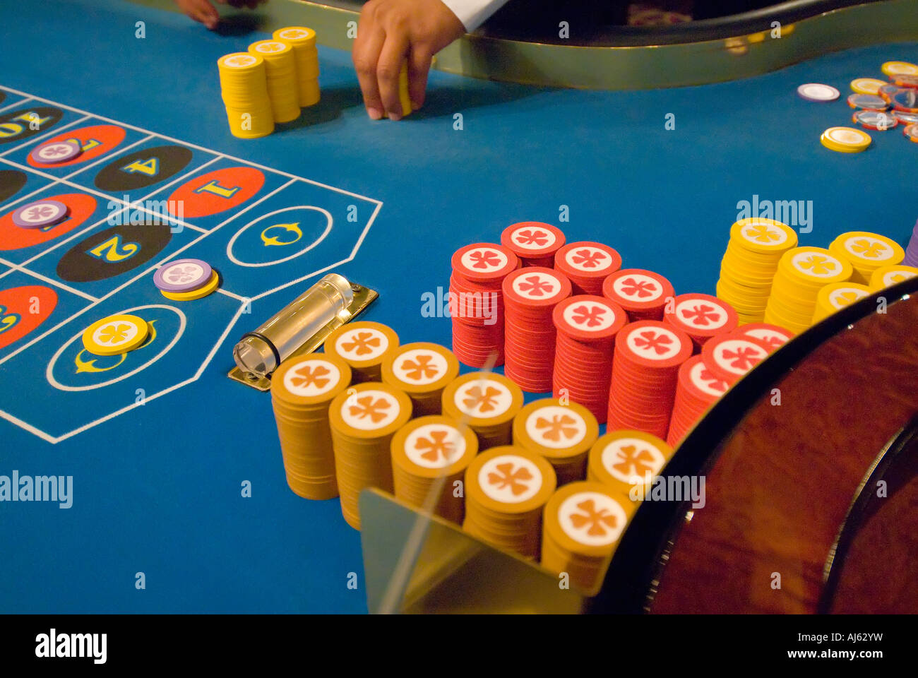 Gambling stack of colorful betting chips action addiction addictive casino gambling game chance - Stock Image