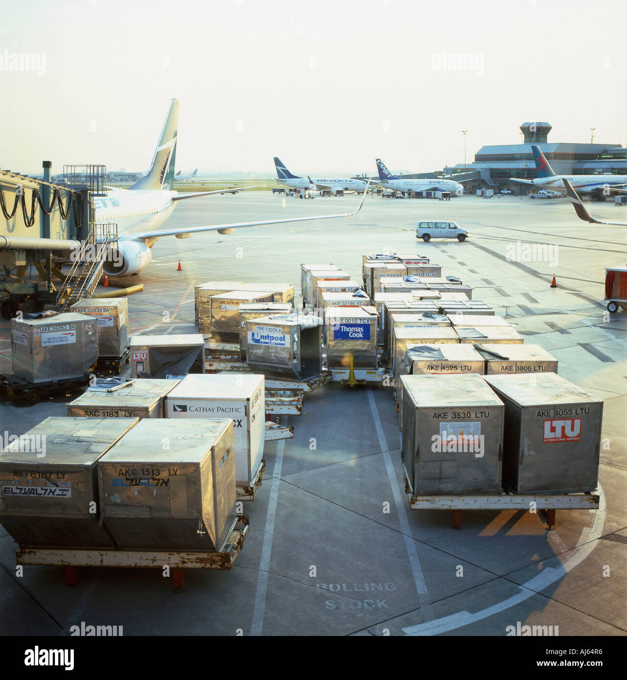 Air cargo being loaded onto planes from the tarmac at Lester Pearson Airport Toronto Ontario Canada - Stock Image
