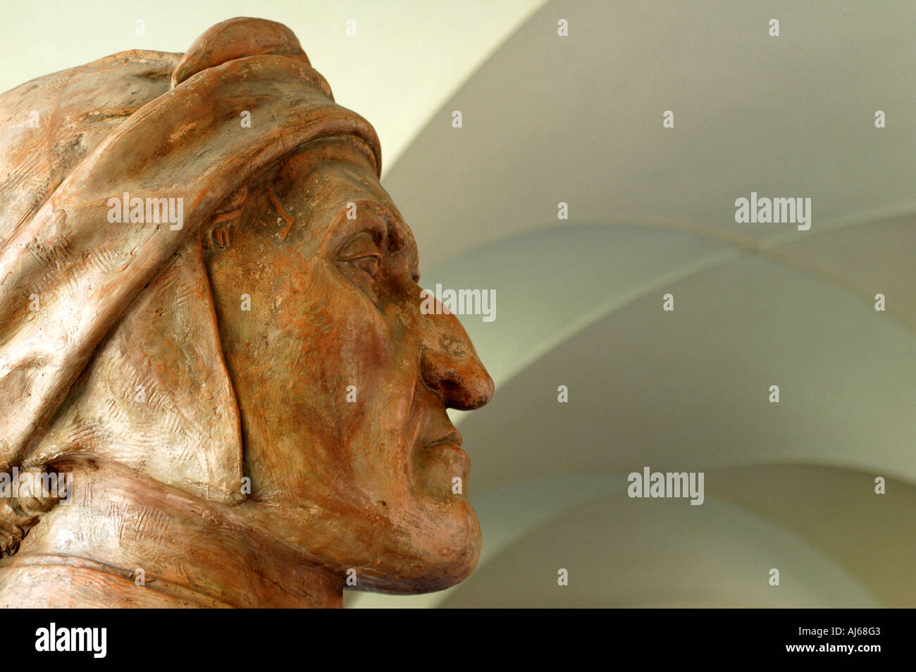 A bust of Italian poet Dante Alighieri in the cloister of the Museo Dantesco in Ravenna Emilia Romagna Italy - Stock Image