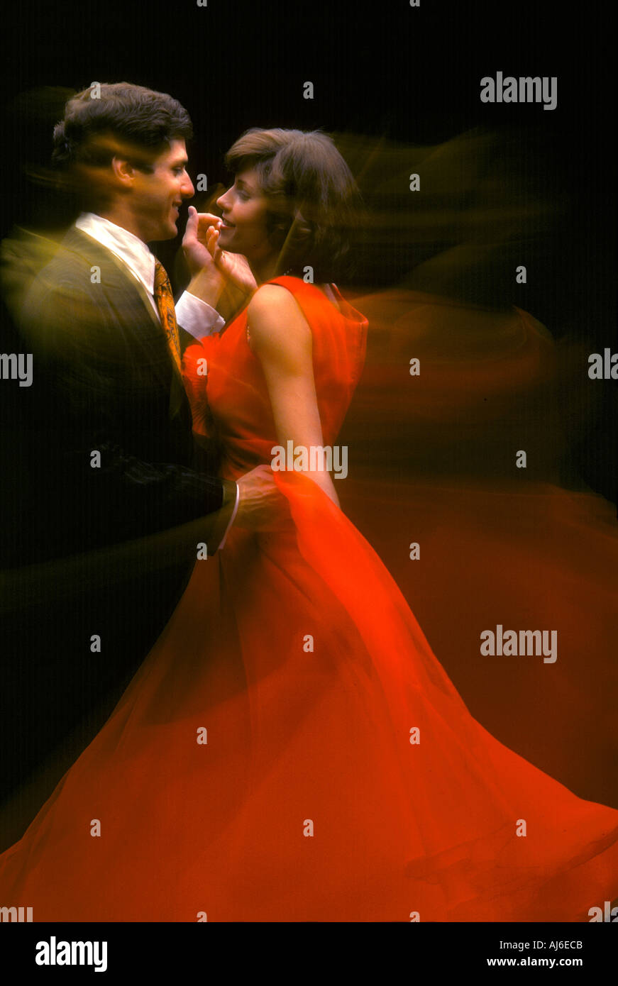 8cac2cf5f6be Man dancing with woman in red dress Stock Photo: 1208010 - Alamy