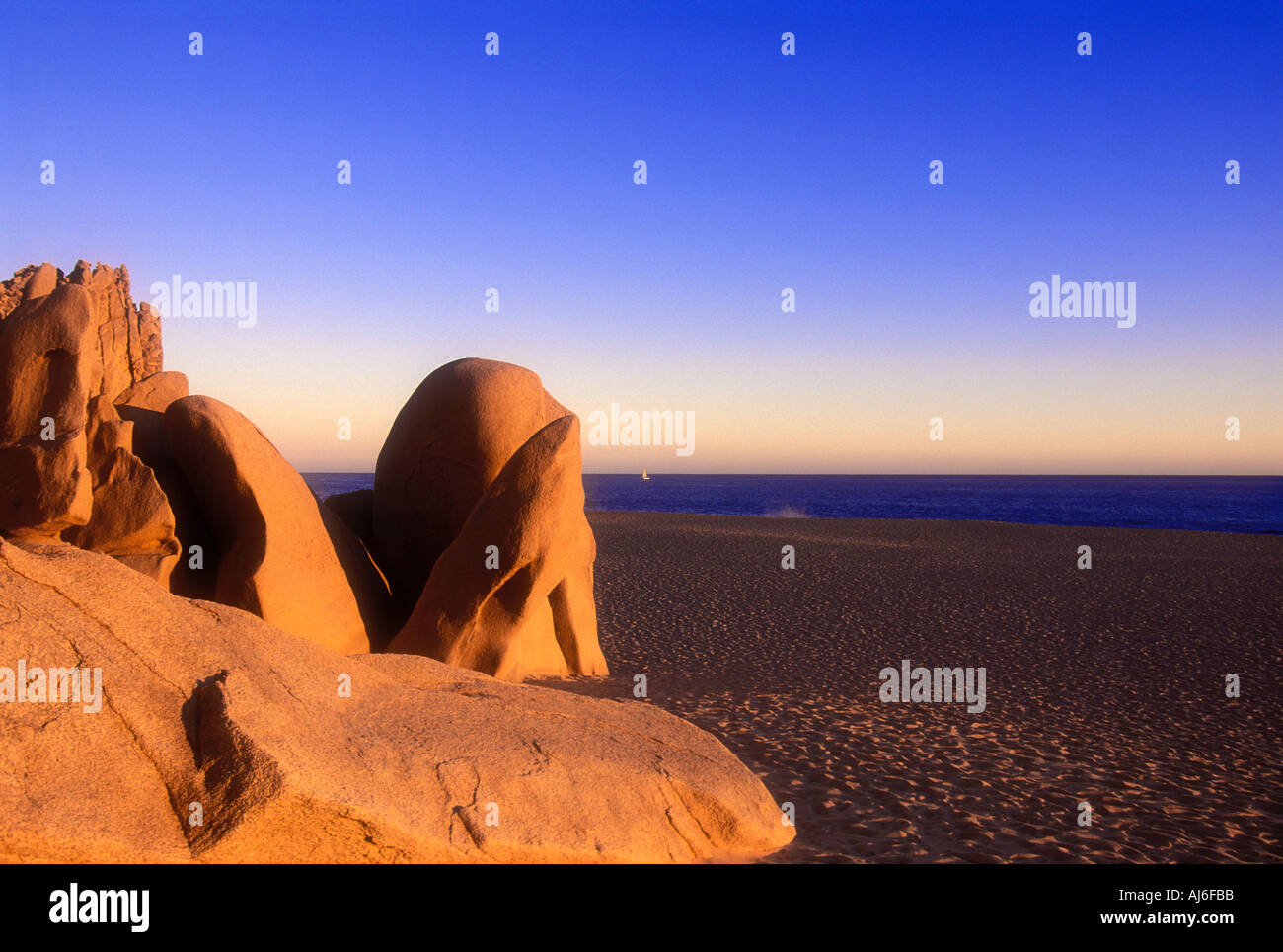 Rocks on beach with Pacific Ocean in background in Cabo san Lucas