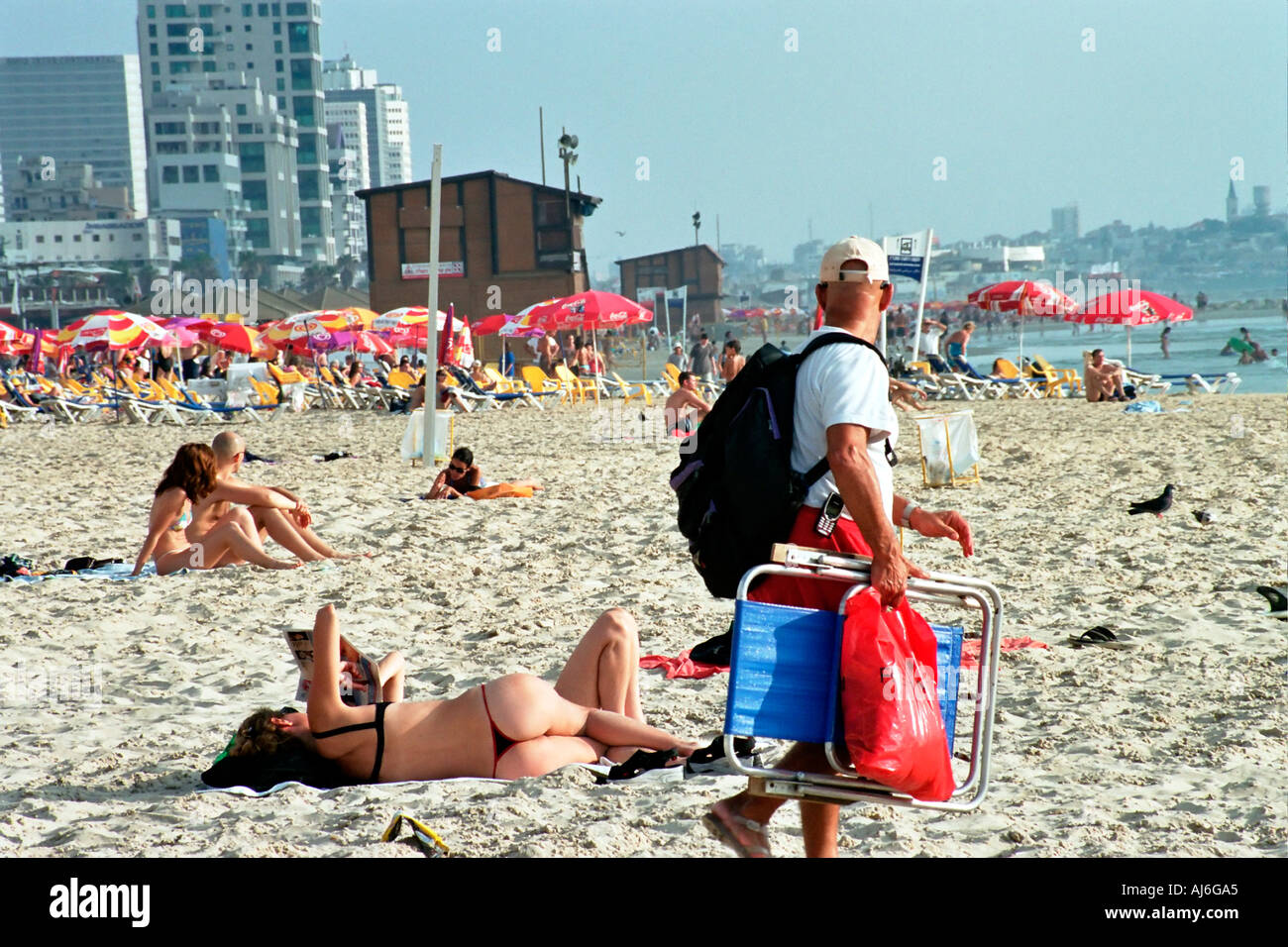722c24f88c729d Israel Tel Aviv Man staring at a woman sun bathing with a thong ...
