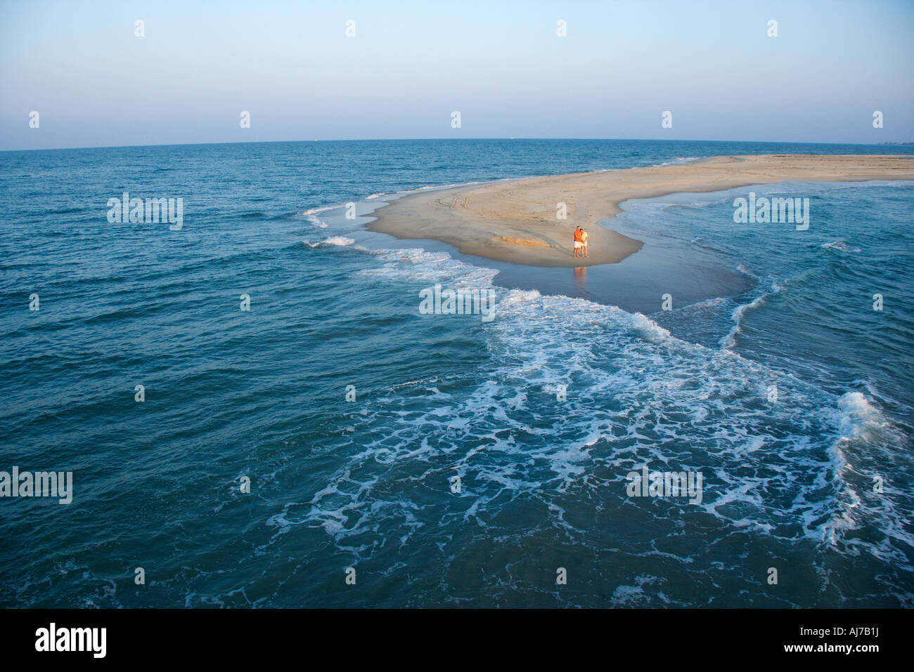 birds eye view of couple on sandbar in bald head island north stock
