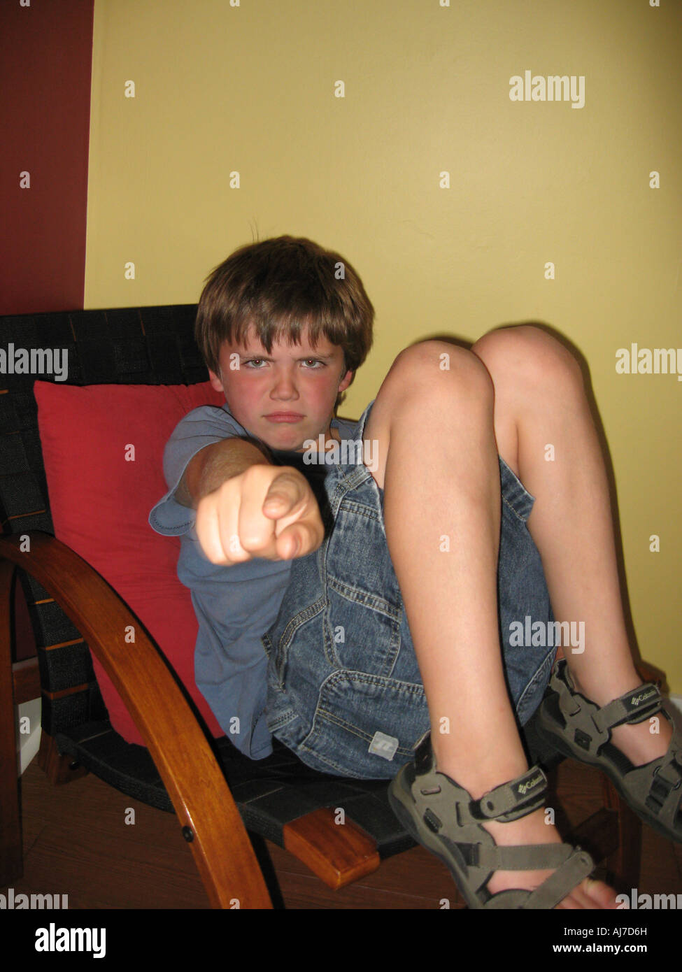 Angry boy pointing accusing finger - Stock Image