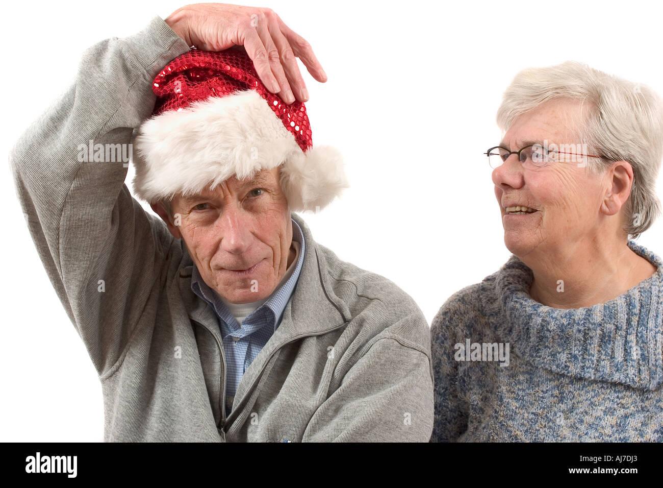Older couple preparing for christmas - Stock Image