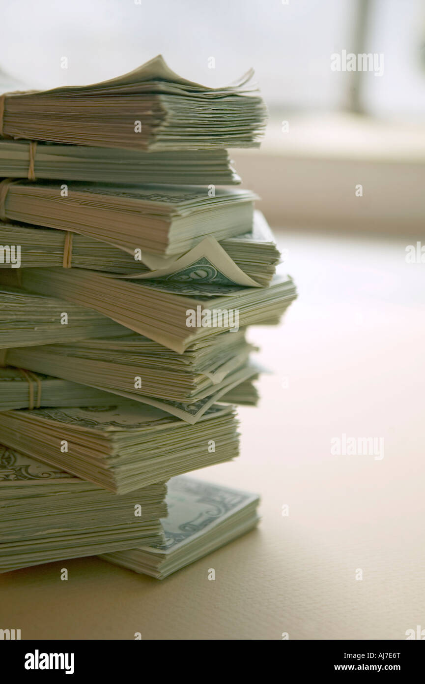 stack of money with window  in background - Stock Image