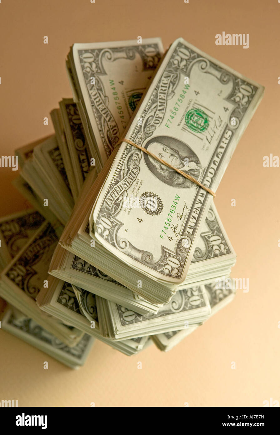 stack of money in pile with 20 dollar bills - Stock Image