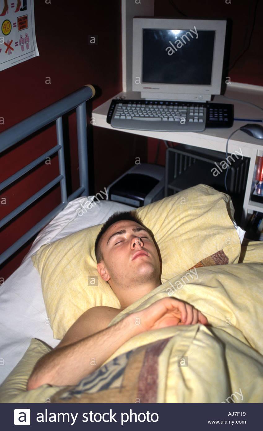 16 year old boy asleep in his bed in bedroom UK Stock ...