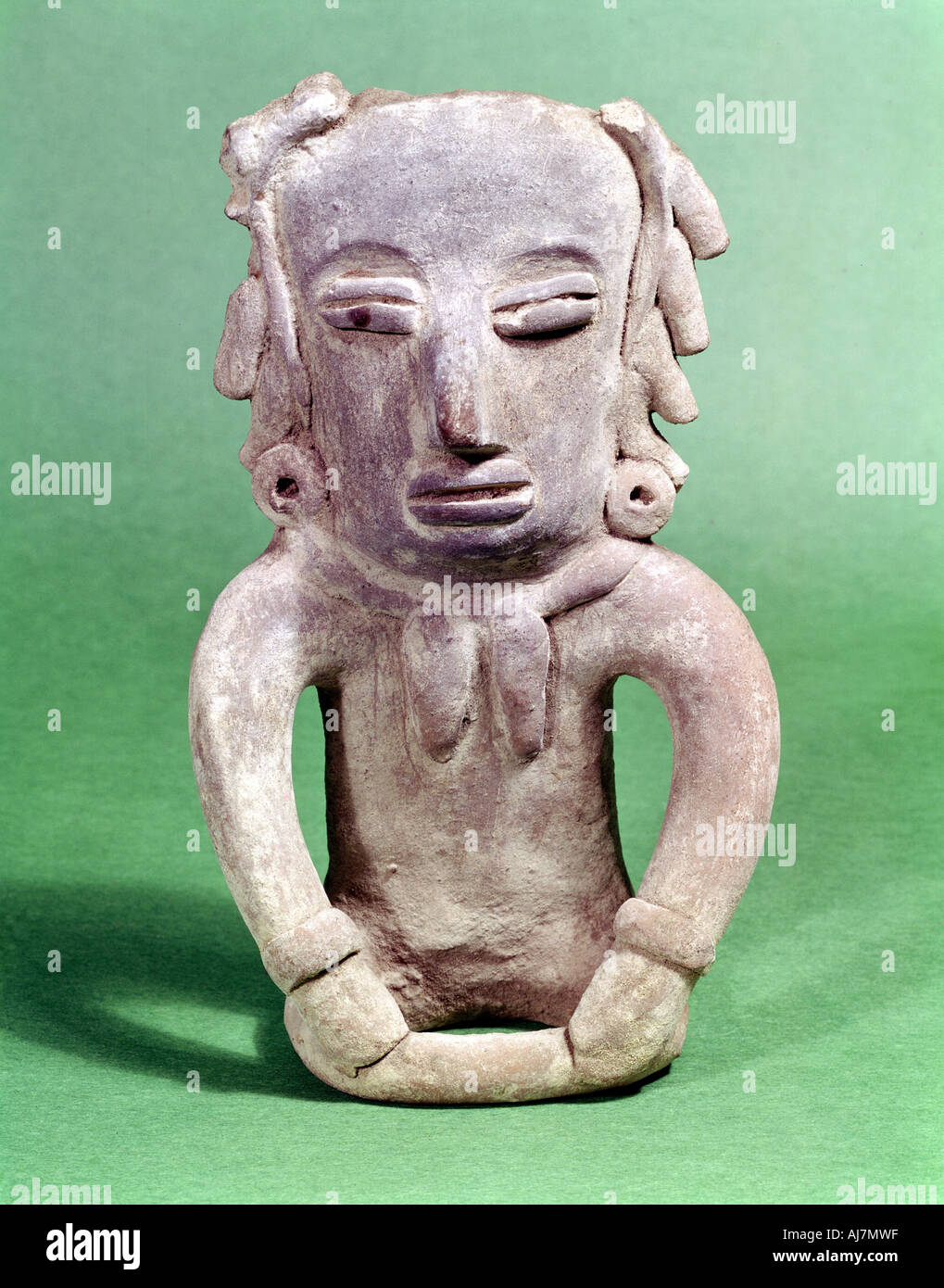 Pre Colombian Mexican seated pottery figure  - Stock Image