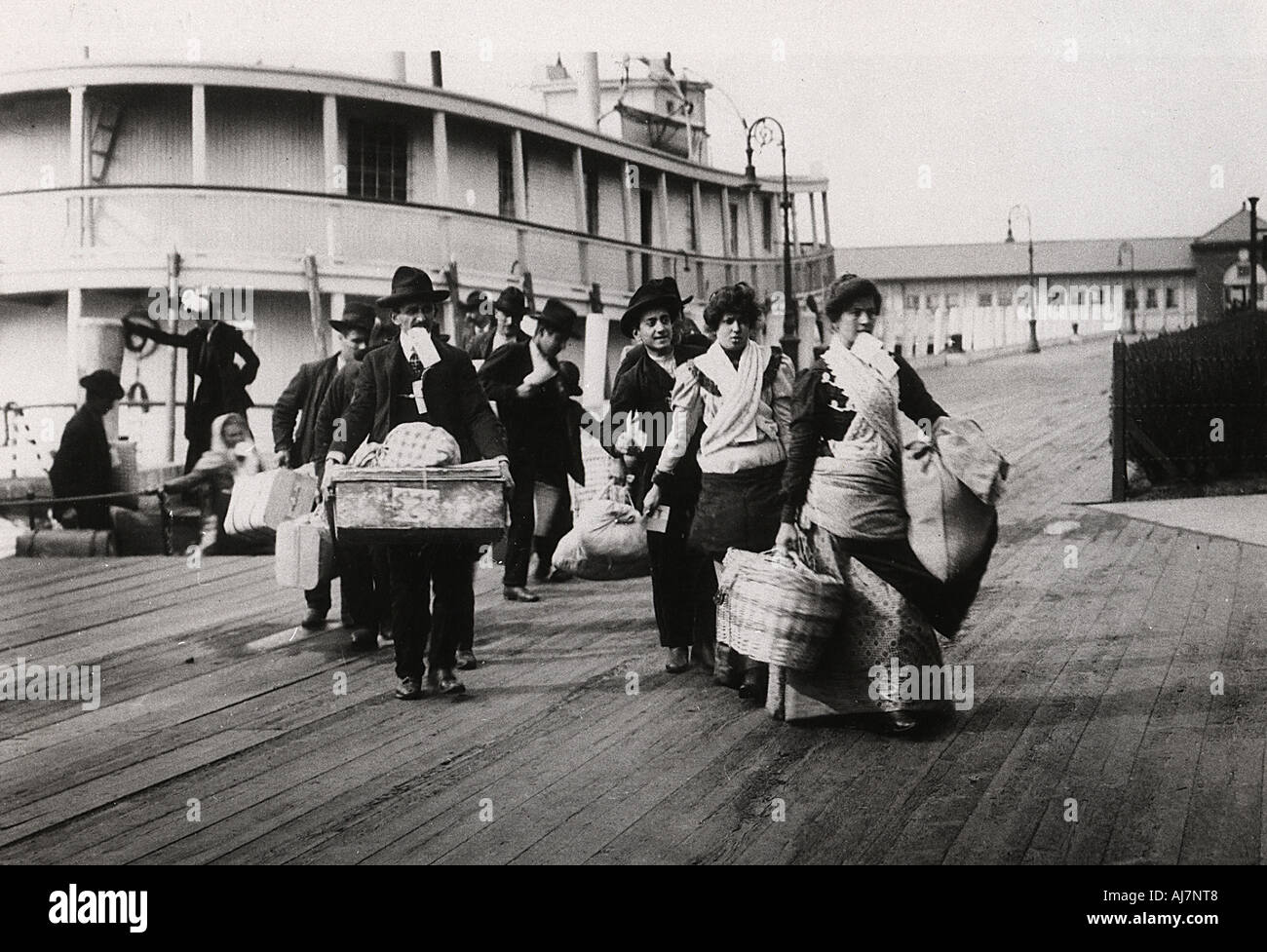 Immigrants to the USA landing at Ellis Island New York c1900  Stock Photo