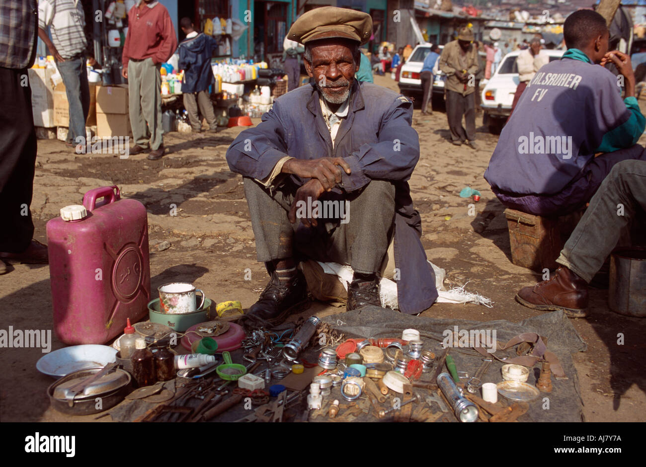 Old man selling junk at the Mercato - the largest market in Africa ...