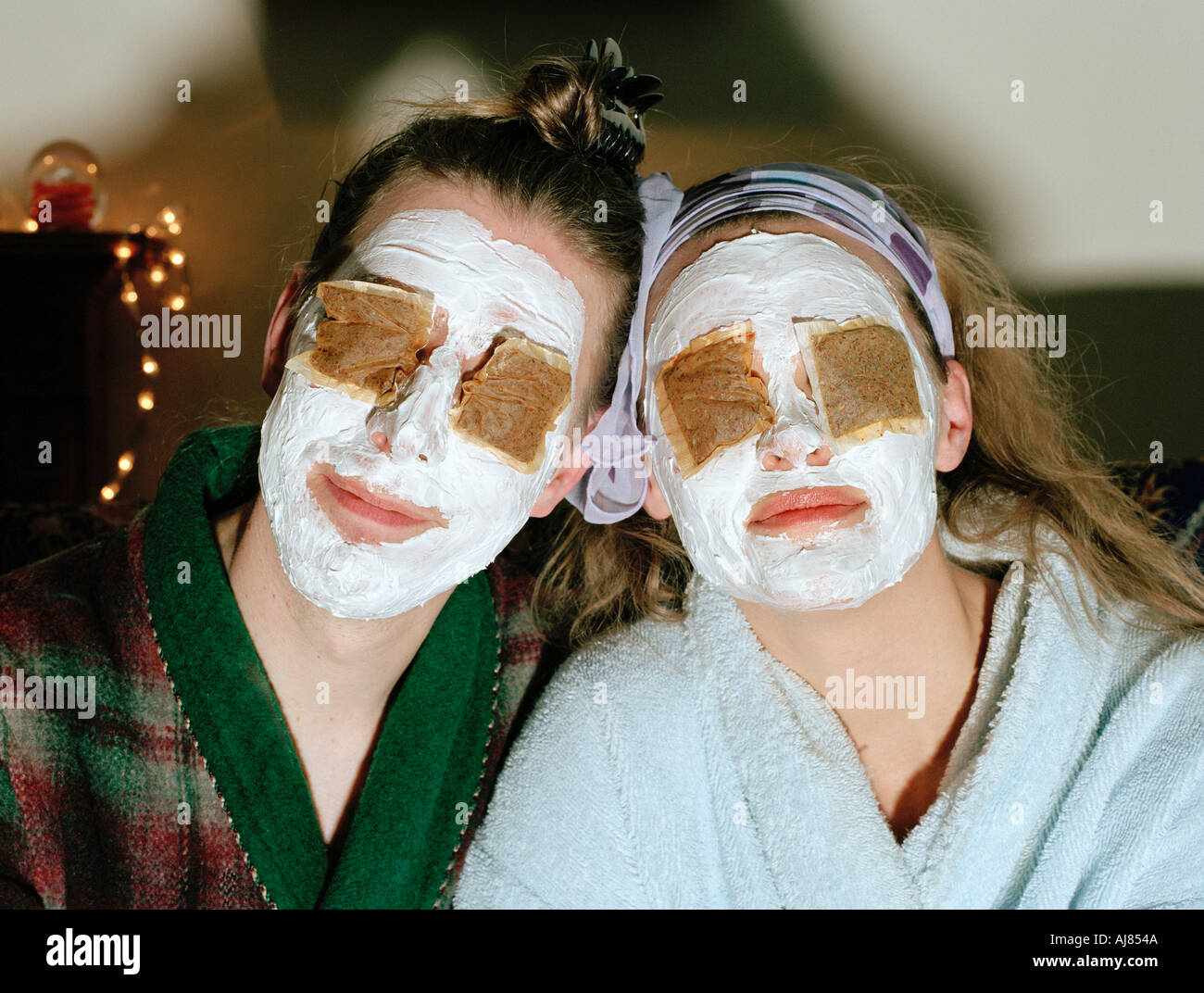 couple with teabags and face cream portrait - Stock Image