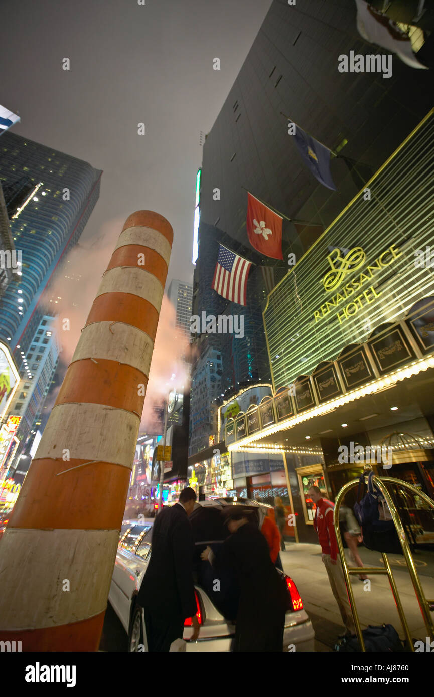 Steam vent in street outside the Renaissance Hotel in Times Square New York NY - Stock Image