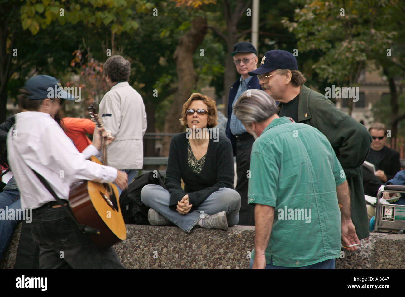Greenwich Village residents gather to make and listen to music at Washington Square Park New York NY no model release editor - Stock Image