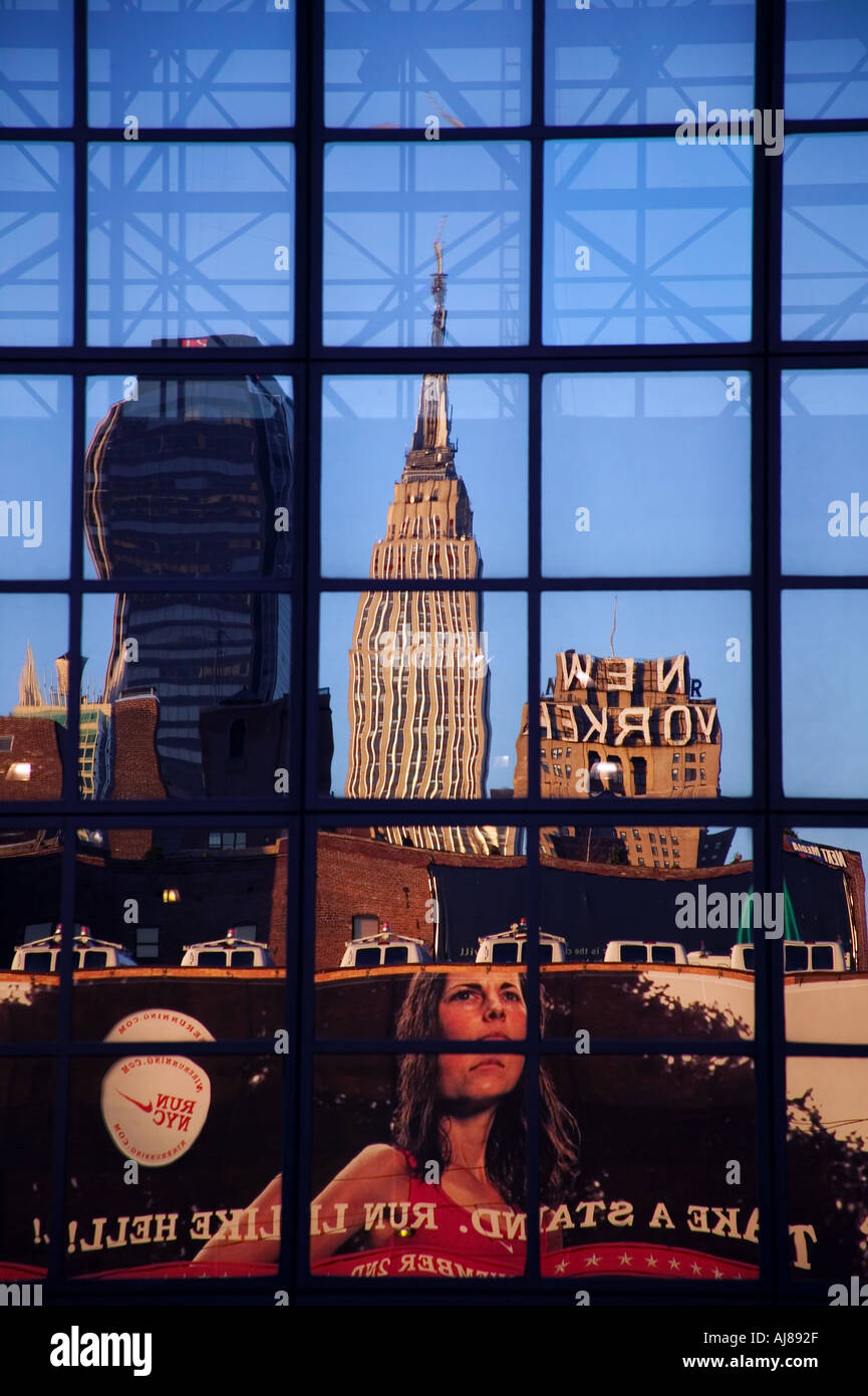 Empire State Building along with portion of NYC skyline reflected in the glass surface of the Javits Convention Stock Photo