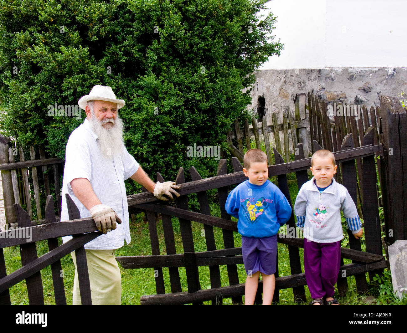 Old man and two children in Holloko village, Hungary Stock Photo