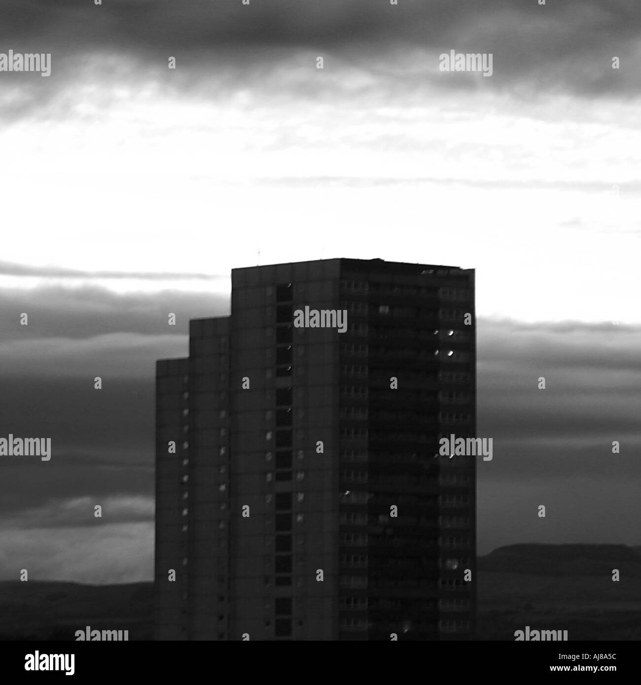 High rise against cloudy sky - Stock Image