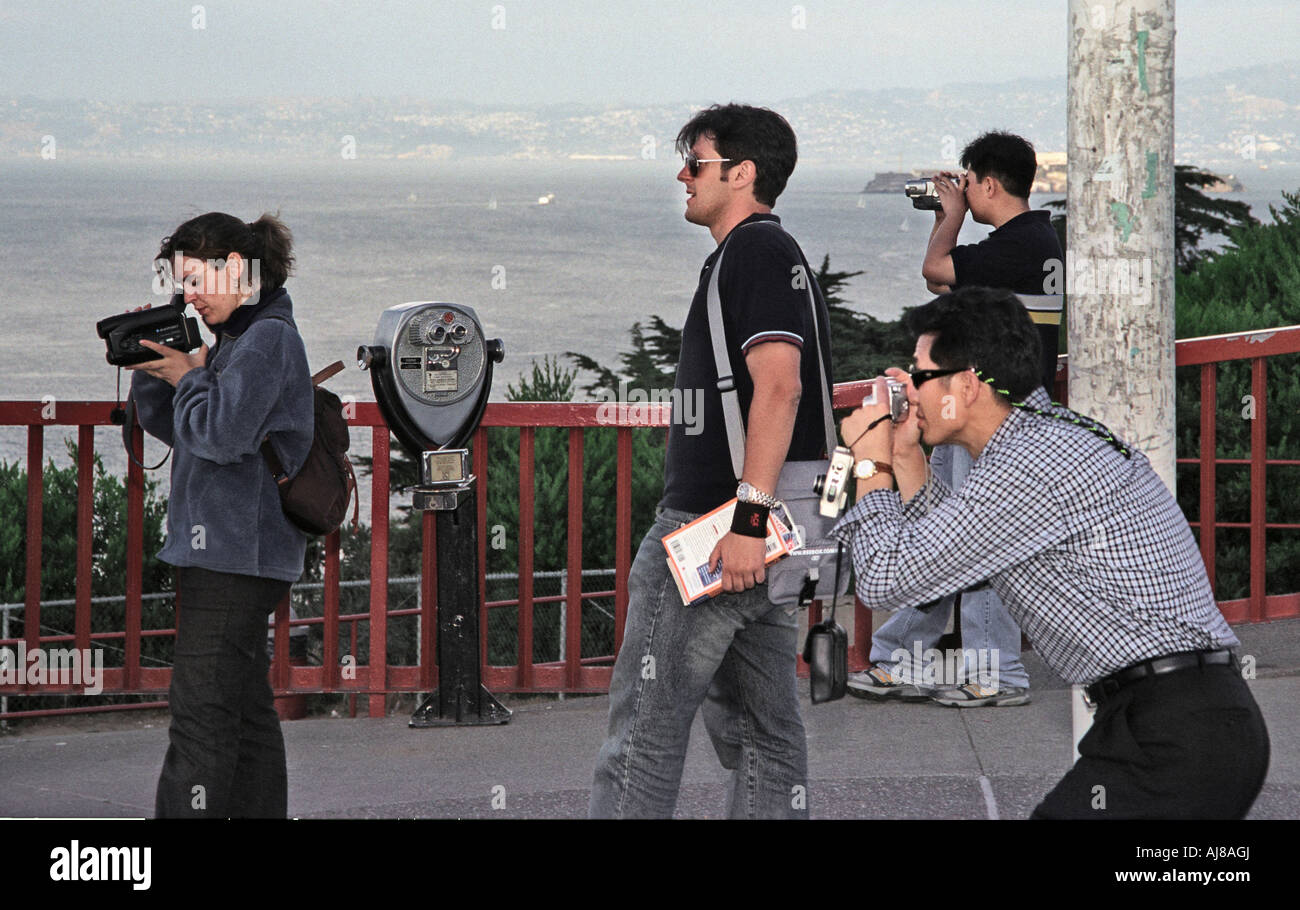 Tourists at the Golden Gate Bridge in San Francisco California snap photos and take video July 2003 Stock Photo