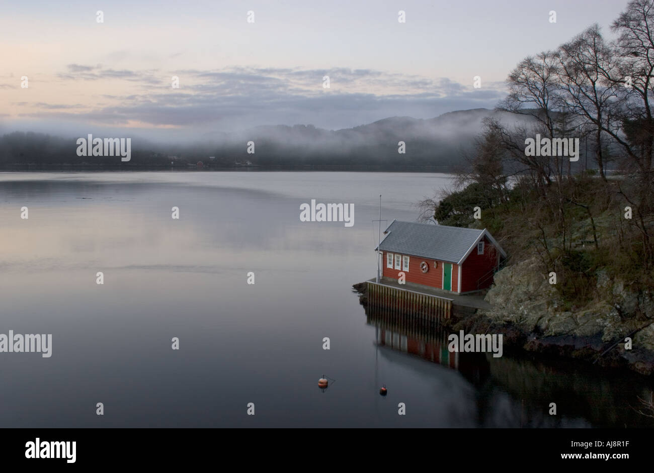Small seahouse by the fjord. - Stock Image