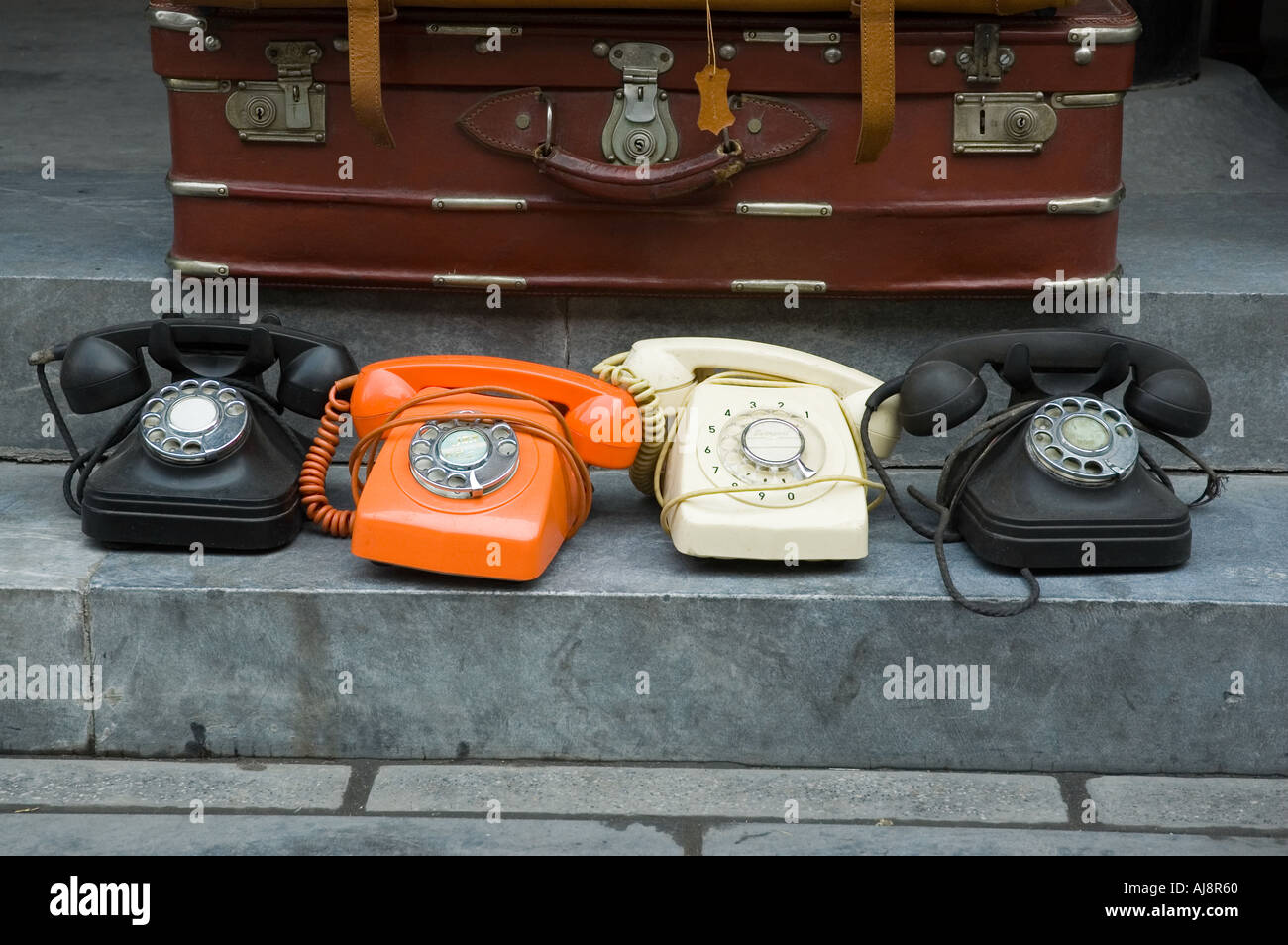 Bakelite telephones at antique market stall - Stock Image