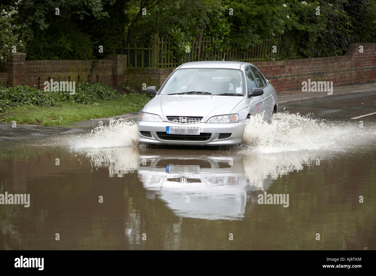 Car diving through flood water in Leconfield East Yorkshire UK June 2007 - Stock Image