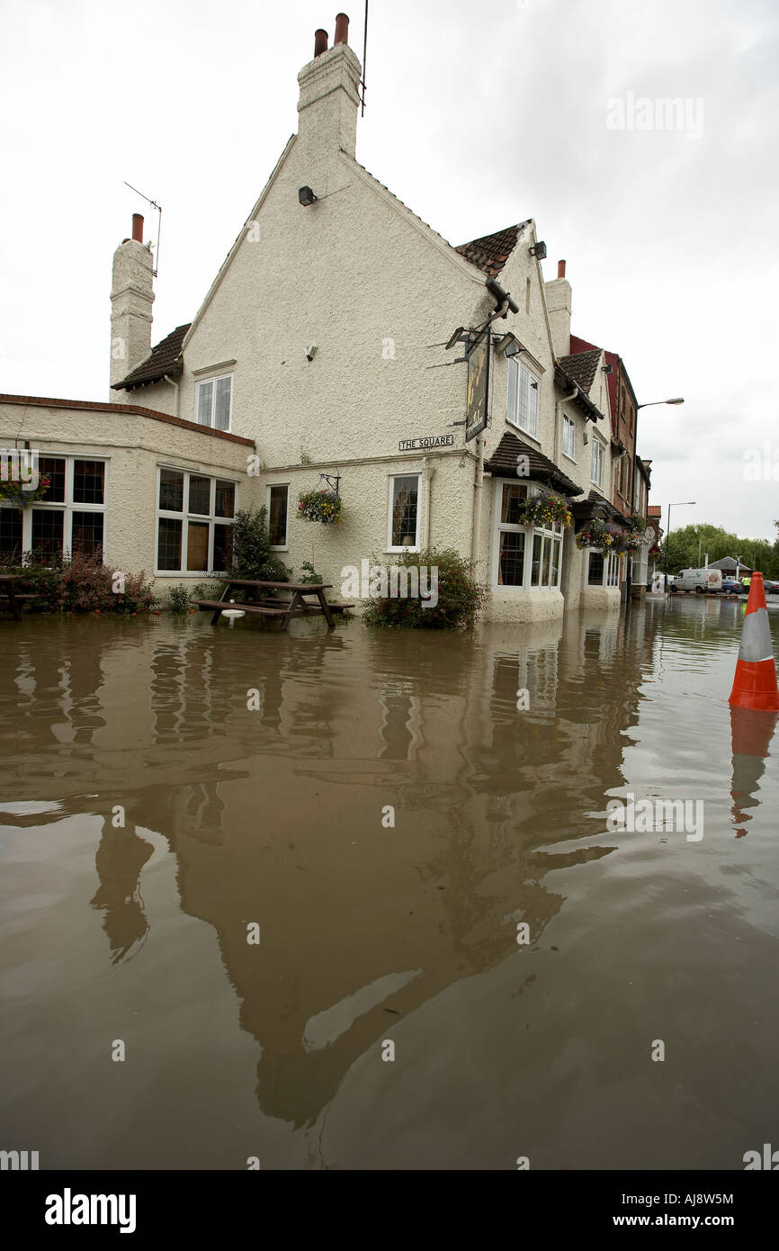 Flooded pub and shops in Stamford Bridge East Yorkshire UK June 2007 - Stock Image