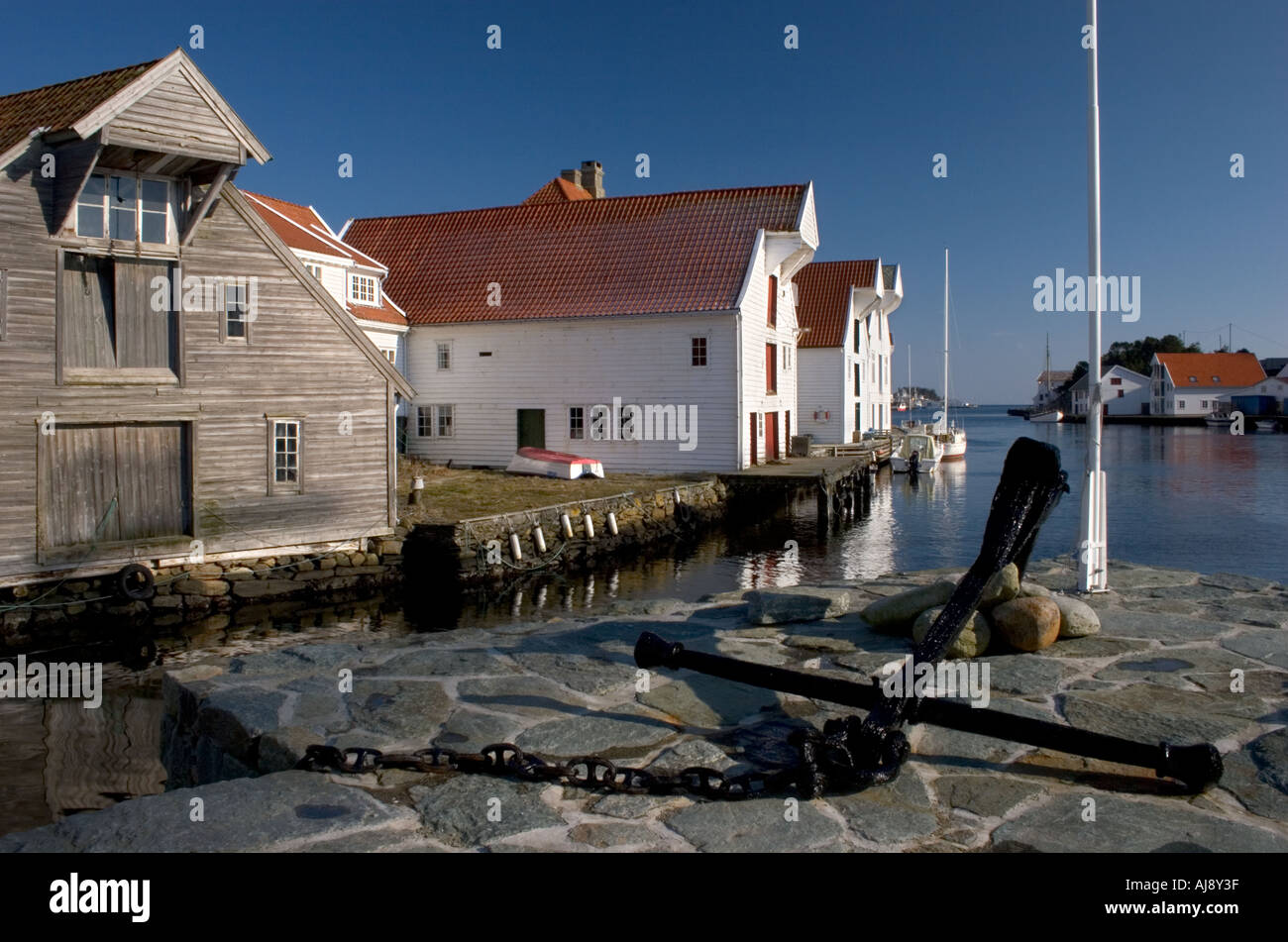 Old, traditional wooden houses in the small town of Skudeneshavn. - Stock Image