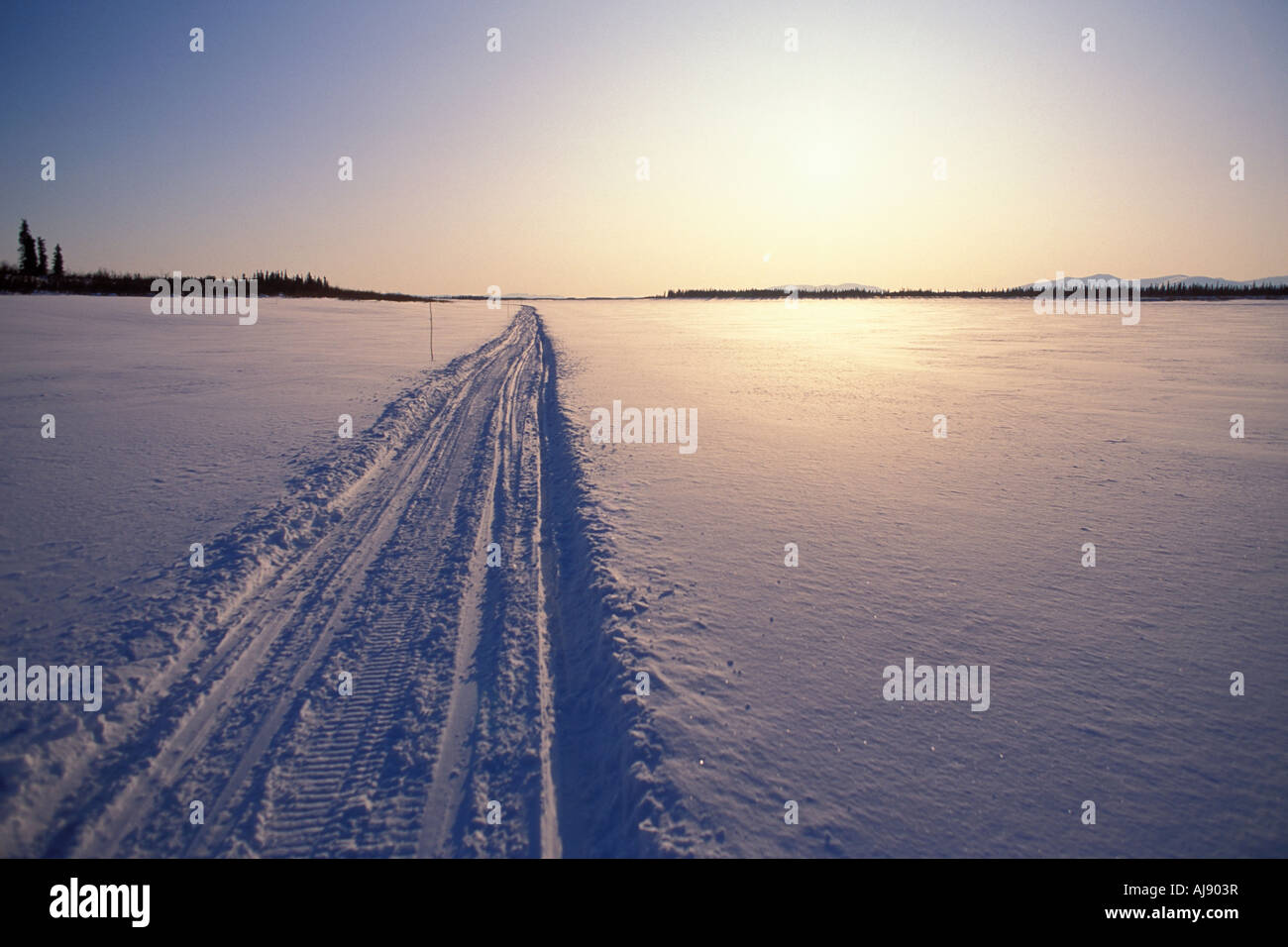 Snowmobile trail in arctic tundra. - Stock Image