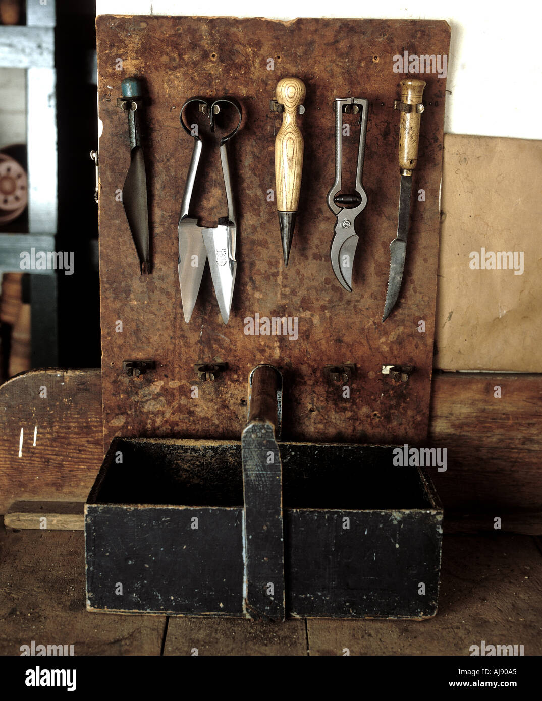 Gardners tools diaplayed in a gardeners shed insinuating hard work ni all the weather times of year - Stock Image