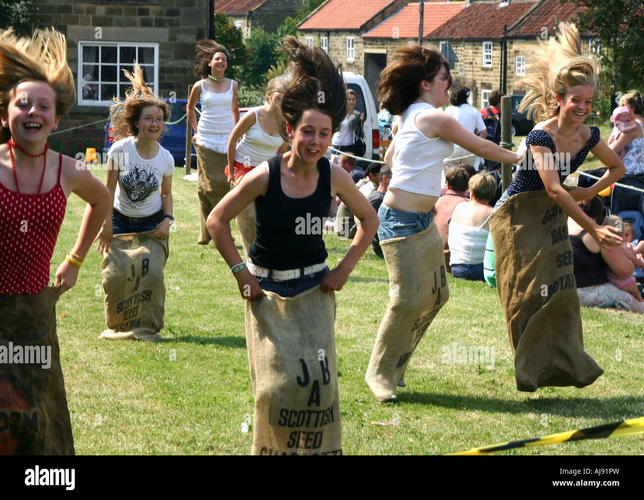 teenage girls in the Sack Race at the Osmotherley Village Games, Yorkshire, england - Stock Image