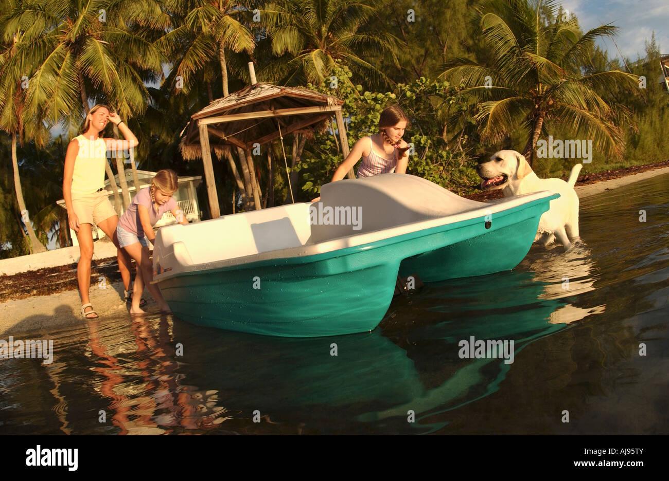 Sisters ready a new paddleboat, Florida. Stock Photo