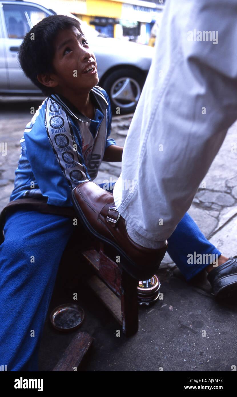 Peruvian boy shoe shining - Stock Image