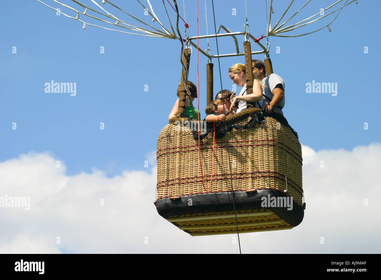 People in Hot air balloon basket in the sky Stock Photo