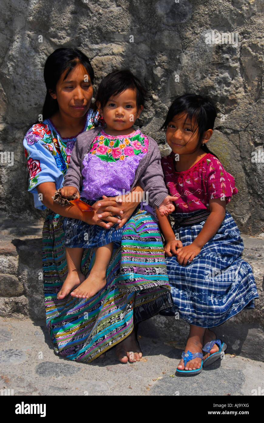 Indigenous family in traditional Mayan dress Stock Photo