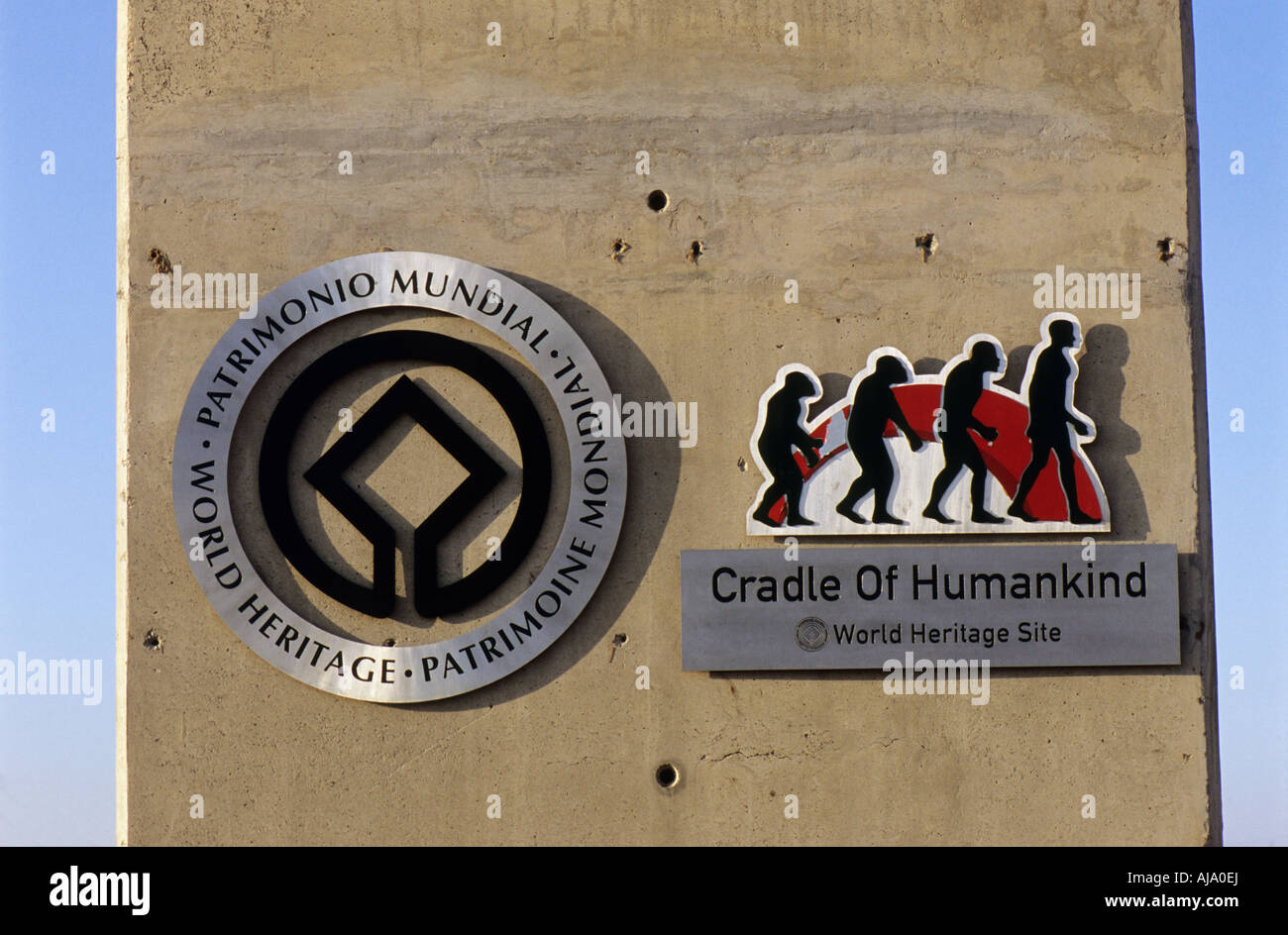 Signs on concrete pillar Cradle of Humankind World Heritage site evolution ape to man Johannesburg South Africa - Stock Image