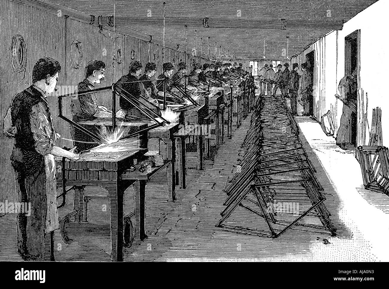 Welding bicycle frames in an American factory 1900  - Stock Image
