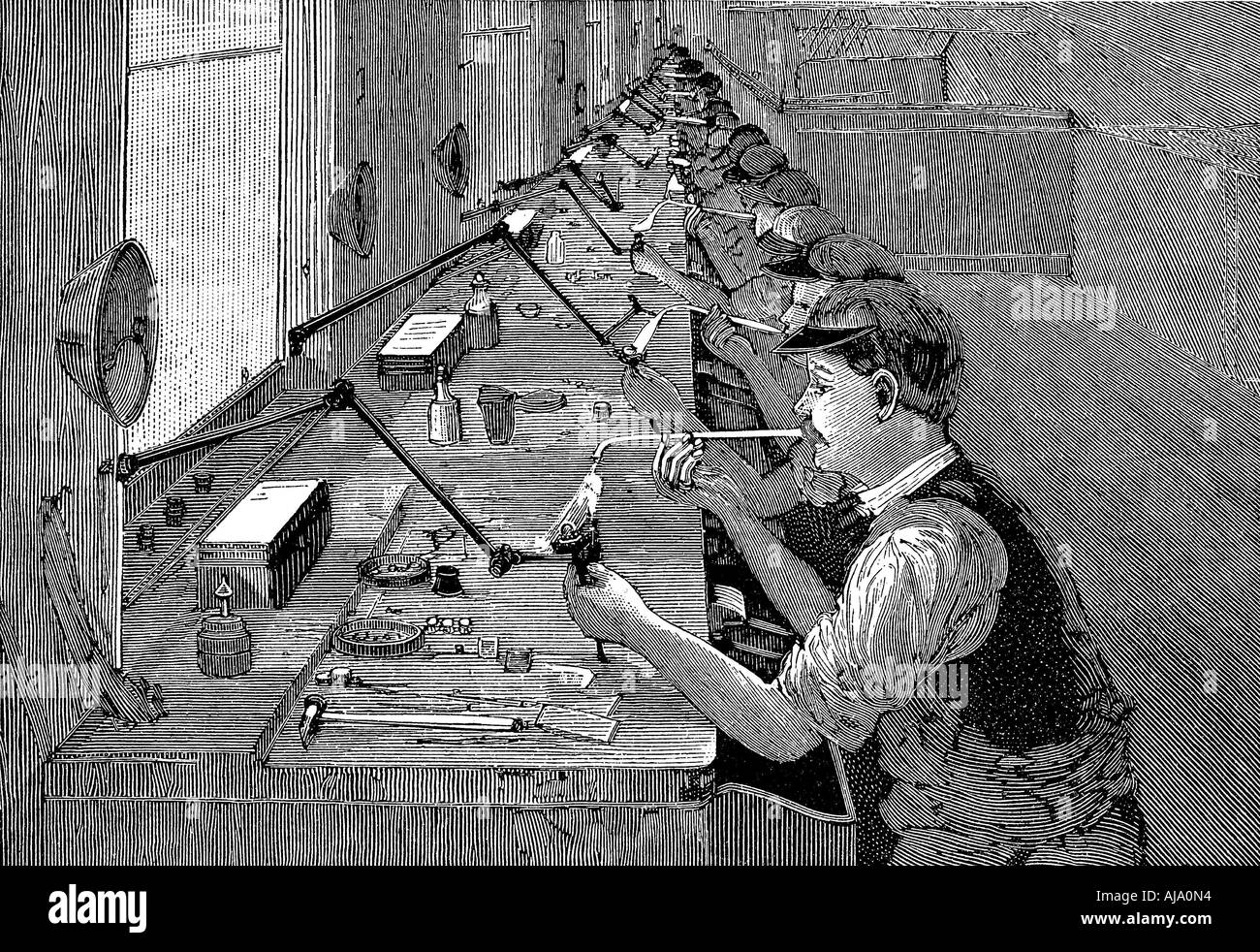 Soldering bicycle parts in an American factory c1900  - Stock Image
