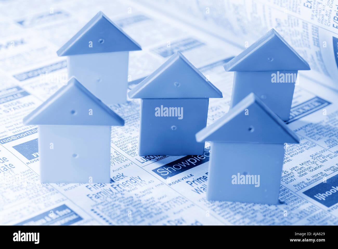 Miniature House Symbols On Real Estate Advertisements Stock Photo