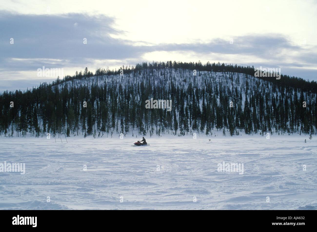 Jukkas Jarvi Lappland Sweden Skidoo on frozen lake - Stock Image