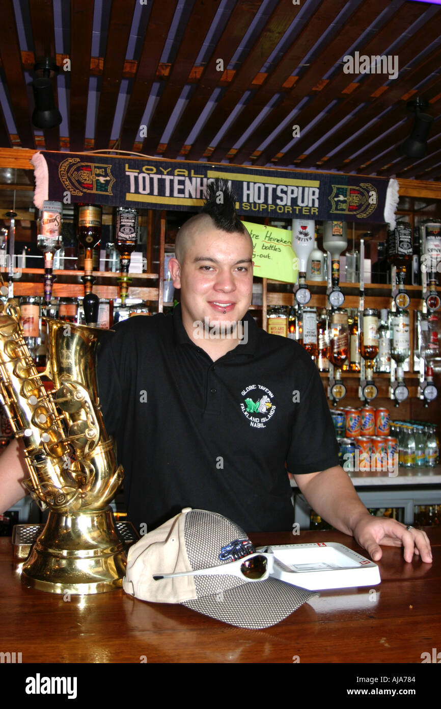 punk barman in the Globe Pub in Stanley on the Falkland Islands - Stock Image