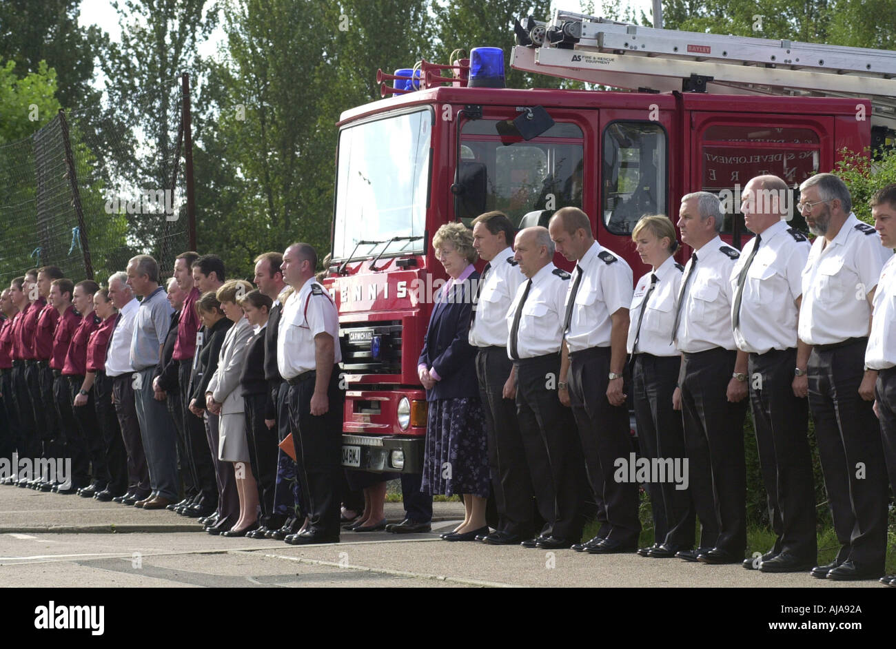 Fire crews observe three minutes silence as a mark of respect for the people that died in the twin tower attacks of 9 11 UK - Stock Image
