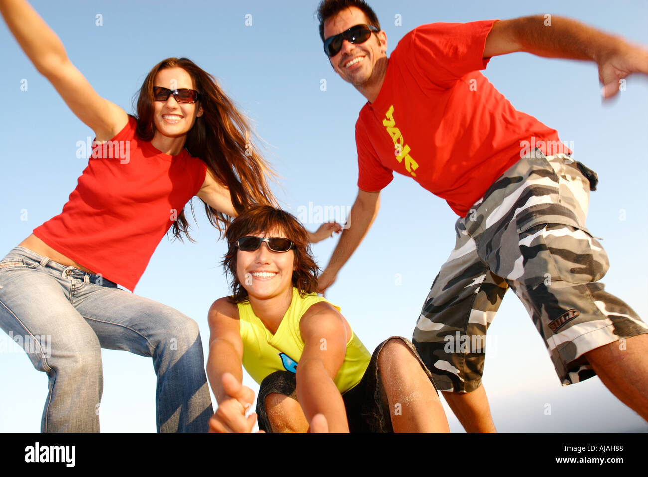Fun group of friends in colourful urban clothes - Stock Image