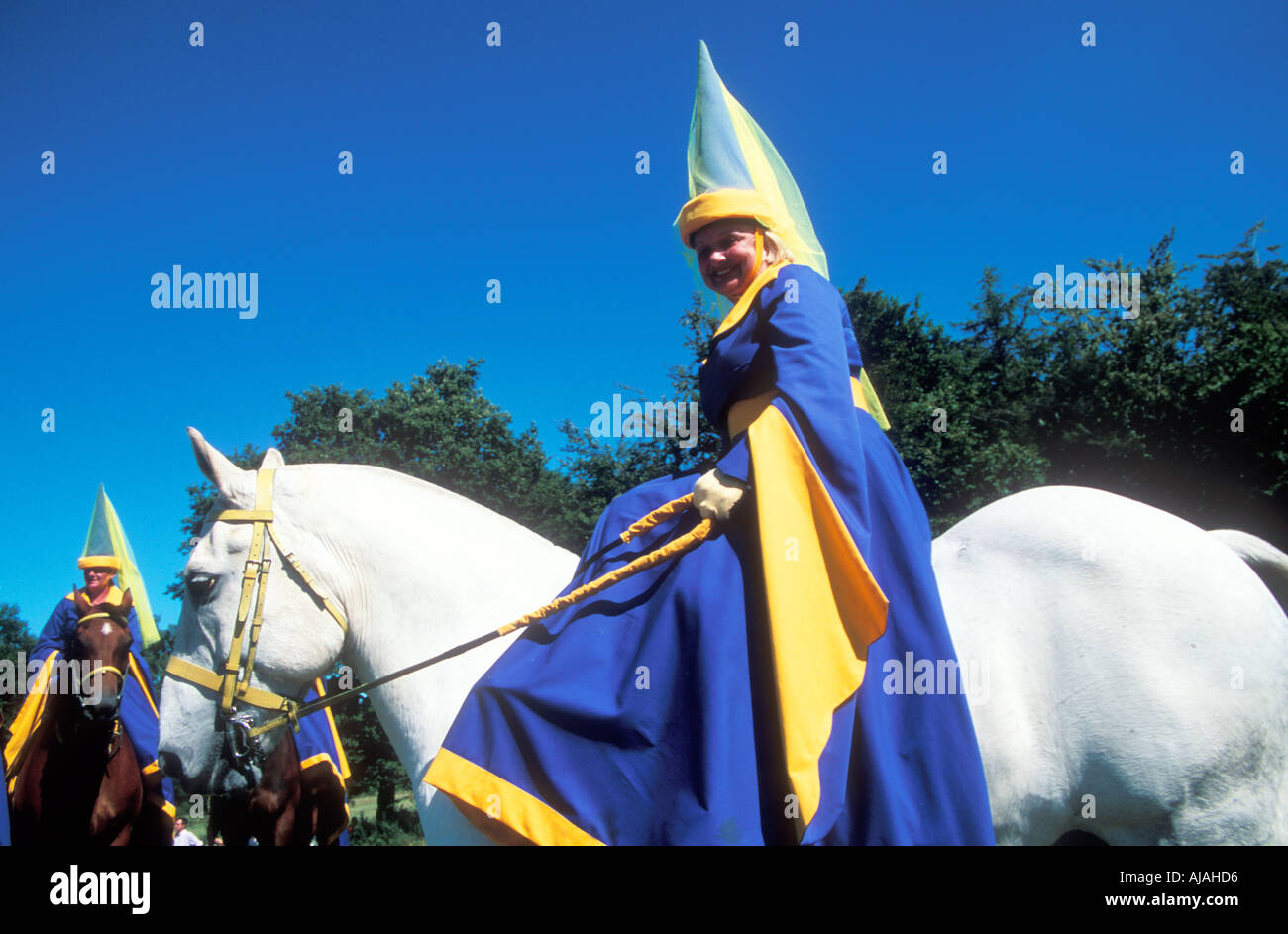 Medieval woman riding at Herstmonceux castle - Stock Image