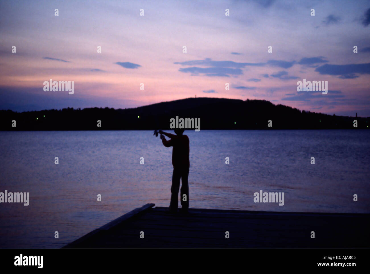 sweden ostersund midnight sun fishing in the lake at midnight - Stock Image