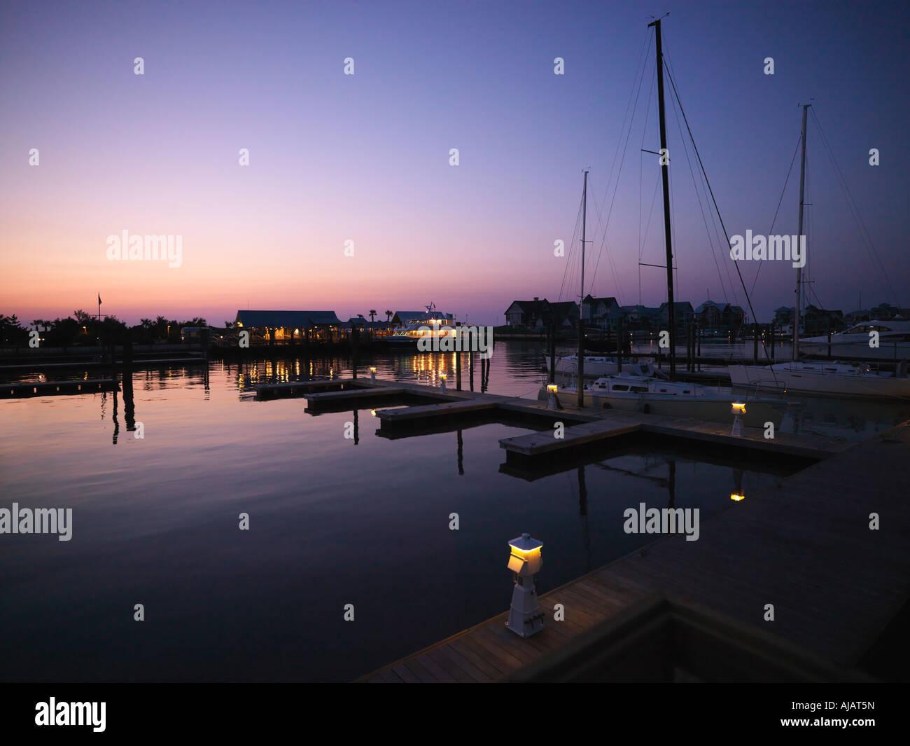 Ferry boat and sail boats at marina at dusk at Bald Head Island North Carolina - Stock Image