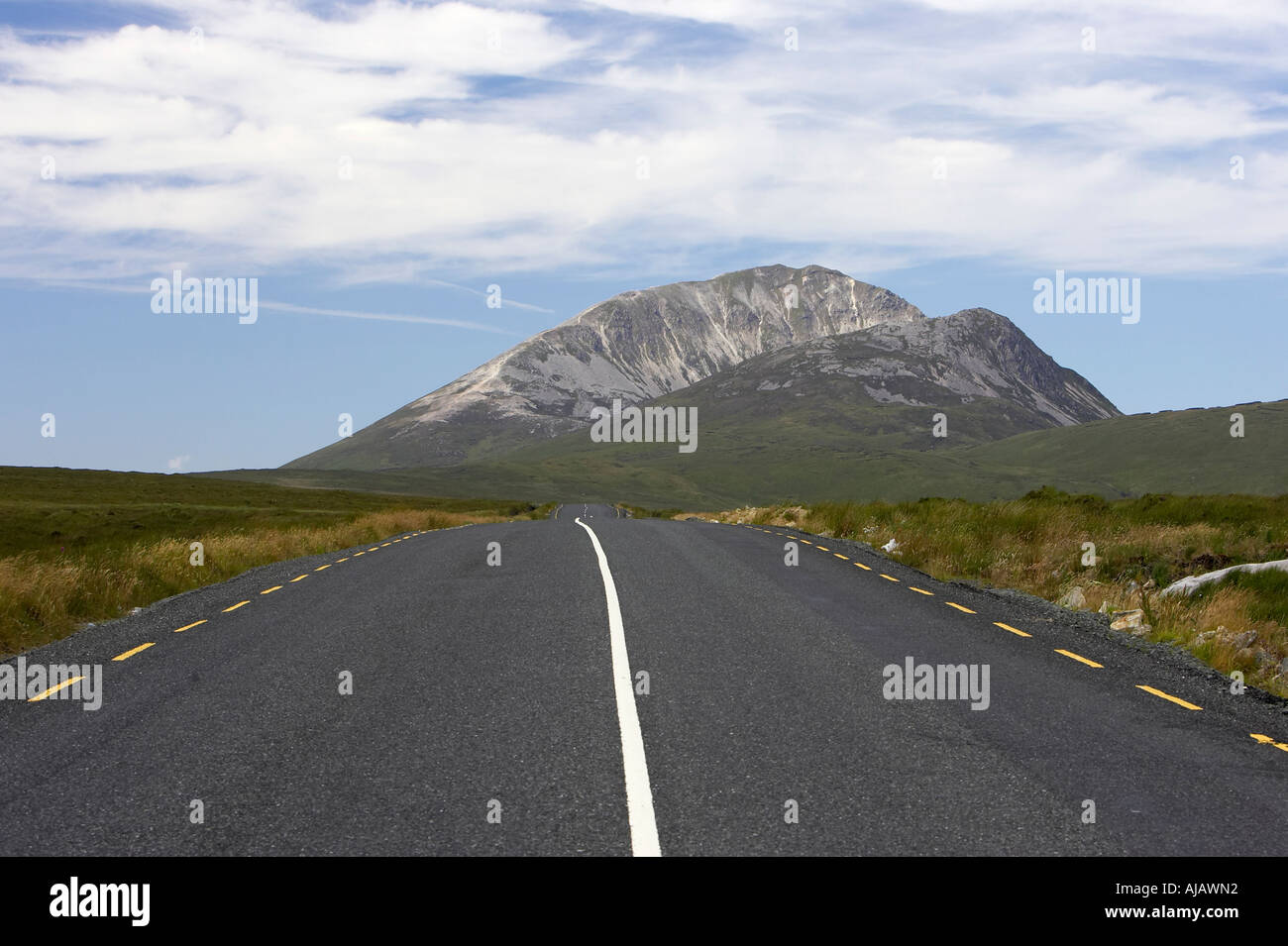 open road at Errigal mountain donegals highest peak against a blue sky between dunlewey and letterkenny - Stock Image