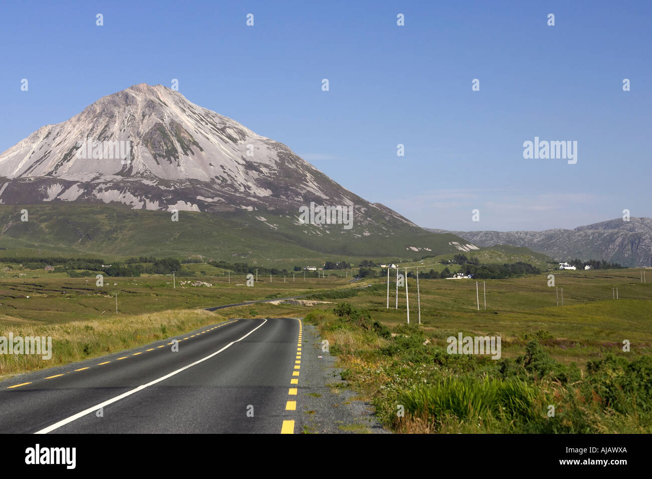 road to dunlewy and Errigal mountain donegals highest peak against a blue sky between dunlewey and gweedore - Stock Image