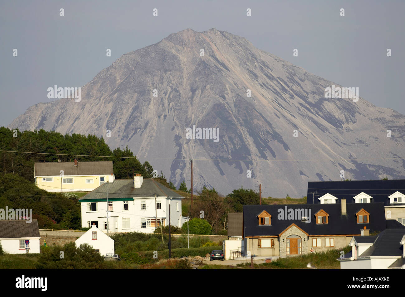 Errigal mountain donegals highest peak with houses in Bunbeg seen from bunbeg beach - Stock Image